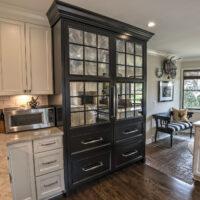 Hardwood Floors And Dark China Cabinet