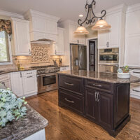Kitchen With Granite Countertop And White Cabinets