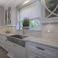 Stainless Farm Sink With White Marble Countertops