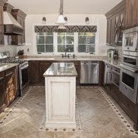 Walnut Kitchen With Mosaic Tile Floor