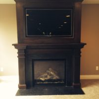 Wooden Fireplace Surrond With TV
