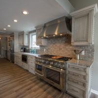Weathered Cabinets With Brick Backsplash