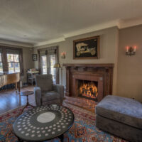 Living Room With Brick Fireplace And Wood Mantel
