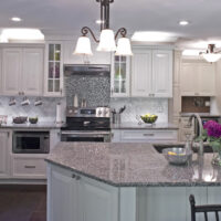 White Stainless Kitchen With Metallic Tile Accent