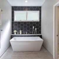 Cobblestone Shower And Dark Hexagon Tile Feature Wall