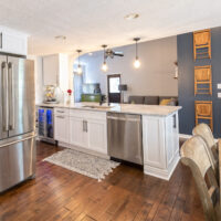 White And Stainless Kitchen With Hrdwood Floors