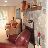 Walkout Basement With Stone Fireplace